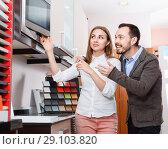 Купить «Young loving couple choosing household appliances for their kitchen in store», фото № 29103820, снято 11 апреля 2018 г. (c) Яков Филимонов / Фотобанк Лори