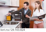 Купить «Young couple choosing new kitchen mixer tap», фото № 29103824, снято 11 апреля 2018 г. (c) Яков Филимонов / Фотобанк Лори