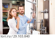 Купить «Married couple visiting furniture salon in search of shower mixer», фото № 29103840, снято 11 апреля 2018 г. (c) Яков Филимонов / Фотобанк Лори