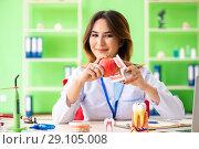 Купить «Woman dentist working on teeth implant», фото № 29105008, снято 11 июня 2018 г. (c) Elnur / Фотобанк Лори