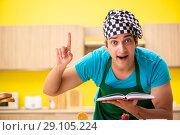 Купить «Man cook preparing cake in kitchen at home», фото № 29105224, снято 13 июня 2018 г. (c) Elnur / Фотобанк Лори