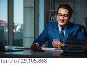 Купить «Young business playing cards late in office», фото № 29105868, снято 9 октября 2017 г. (c) Elnur / Фотобанк Лори
