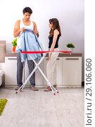 Купить «Young woman doing ironing for her husband», фото № 29106060, снято 27 июня 2018 г. (c) Elnur / Фотобанк Лори