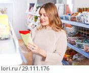 Купить «Woman choosing spices in grocery», фото № 29111176, снято 11 апреля 2018 г. (c) Яков Филимонов / Фотобанк Лори