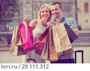 Купить «Young man and woman holding shopping paper bags», фото № 29111312, снято 1 июня 2020 г. (c) Яков Филимонов / Фотобанк Лори