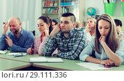 Купить «Bored students sitting at lesson», фото № 29111336, снято 16 декабря 2018 г. (c) Яков Филимонов / Фотобанк Лори