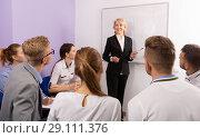 Купить «Female speaker giving presentation for students in lecture hall», фото № 29111376, снято 5 октября 2017 г. (c) Яков Филимонов / Фотобанк Лори