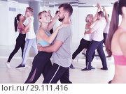 Купить «Joyful dancing pair dance together», фото № 29111416, снято 9 октября 2017 г. (c) Яков Филимонов / Фотобанк Лори