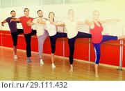 Купить «Happy adults learning to dance ballet», фото № 29111432, снято 20 октября 2018 г. (c) Яков Филимонов / Фотобанк Лори