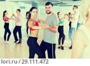 Купить «Positive dancing pair dance together», фото № 29111472, снято 9 октября 2017 г. (c) Яков Филимонов / Фотобанк Лори