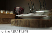 Купить «Snack on the tray On a sunny day on a white tablecloth», видеоролик № 29111848, снято 9 августа 2018 г. (c) Aleksejs Bergmanis / Фотобанк Лори