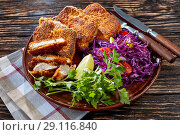 Купить «close up of fried pork chops on a wooden table», фото № 29116840, снято 27 августа 2018 г. (c) Oksana Zh / Фотобанк Лори