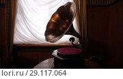 Купить «Vintage gramophone of an ancient castle as an interior design», видеоролик № 29117064, снято 8 августа 2018 г. (c) Aleksejs Bergmanis / Фотобанк Лори