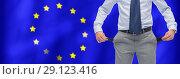 Купить «businessman shows pockets over flag european union», фото № 29123416, снято 29 января 2015 г. (c) Syda Productions / Фотобанк Лори