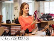 Купить «happy young woman choosing shoes at store», фото № 29123456, снято 22 сентября 2017 г. (c) Syda Productions / Фотобанк Лори
