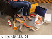 Купить «young woman trying and choosing shoes at store», фото № 29123464, снято 22 сентября 2017 г. (c) Syda Productions / Фотобанк Лори