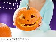 Купить «close up of woman with halloween pumpkin», фото № 29123560, снято 17 сентября 2014 г. (c) Syda Productions / Фотобанк Лори