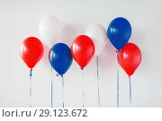 Купить «party decoration with red, white and blue balloons», фото № 29123672, снято 6 июля 2017 г. (c) Syda Productions / Фотобанк Лори