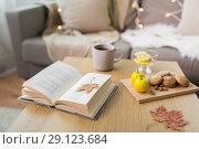 Купить «book, lemon, tea and cookies on table at home», фото № 29123684, снято 15 ноября 2017 г. (c) Syda Productions / Фотобанк Лори