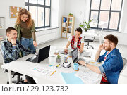 Купить «creative team working on user interface at office», фото № 29123732, снято 1 апреля 2018 г. (c) Syda Productions / Фотобанк Лори