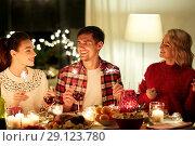 Купить «happy friends celebrating christmas at home feast», фото № 29123780, снято 17 декабря 2017 г. (c) Syda Productions / Фотобанк Лори