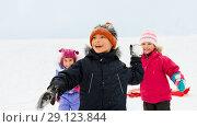 Купить «happy little kids playing outdoors in winter», фото № 29123844, снято 10 февраля 2018 г. (c) Syda Productions / Фотобанк Лори