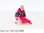 Купить «happy little girl sliding down on sled in winter», фото № 29123848, снято 10 февраля 2018 г. (c) Syda Productions / Фотобанк Лори