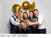 Купить «happy friends clinking champagne glasses at party», фото № 29123860, снято 3 марта 2018 г. (c) Syda Productions / Фотобанк Лори