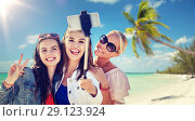 group of smiling women taking selfie on beach. Стоковое фото, фотограф Syda Productions / Фотобанк Лори