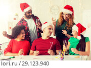 Купить «happy team celebrating christmas at office party», фото № 29123940, снято 3 сентября 2017 г. (c) Syda Productions / Фотобанк Лори