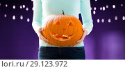 Купить «close up of woman holding halloween pumpkin», фото № 29123972, снято 17 сентября 2014 г. (c) Syda Productions / Фотобанк Лори