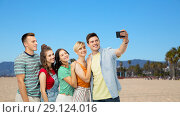 Купить «friends taking selfie over venice beach», фото № 29124016, снято 30 июня 2018 г. (c) Syda Productions / Фотобанк Лори