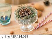 Купить «christmas fir decoration with cone in dessert bowl», фото № 29124088, снято 15 ноября 2017 г. (c) Syda Productions / Фотобанк Лори