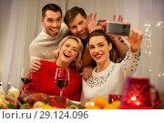 Купить «friends taking selfie at christmas dinner», фото № 29124096, снято 17 декабря 2017 г. (c) Syda Productions / Фотобанк Лори