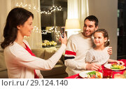 Купить «happy family taking picture at christmas dinner», фото № 29124140, снято 11 января 2018 г. (c) Syda Productions / Фотобанк Лори