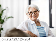 Купить «portrait of happy senior woman in glasses at home», фото № 29124204, снято 24 мая 2018 г. (c) Syda Productions / Фотобанк Лори