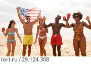 Купить «friends at american independence day beach party», фото № 29124308, снято 29 июля 2018 г. (c) Syda Productions / Фотобанк Лори