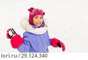 Купить «happy girl playing and throwing snowball in winter», фото № 29124340, снято 10 февраля 2018 г. (c) Syda Productions / Фотобанк Лори