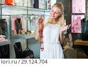 Купить «Woman buying long necklace», фото № 29124704, снято 21 октября 2018 г. (c) Яков Филимонов / Фотобанк Лори