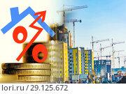 Купить «Символ процента на фоне строительства нового жилого района», фото № 29125672, снято 14 февраля 2020 г. (c) Сергеев Валерий / Фотобанк Лори
