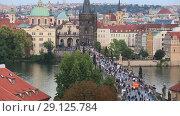 Купить «Прага, вид сверху на башню, Карлов мост и люди на мосту», видеоролик № 29125784, снято 19 сентября 2018 г. (c) Яна Королёва / Фотобанк Лори