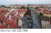 Купить «Вид сверху на город Прага, крыши домов и Карлов мост», видеоролик № 29125788, снято 19 сентября 2018 г. (c) Яна Королёва / Фотобанк Лори
