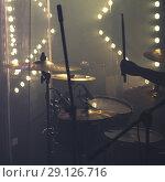 Купить «Drum set with cymbals and drummer hand», фото № 29126716, снято 11 декабря 2016 г. (c) EugeneSergeev / Фотобанк Лори