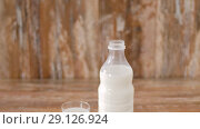 Купить «lactose free milk and almonds on wooden table», видеоролик № 29126924, снято 21 августа 2018 г. (c) Syda Productions / Фотобанк Лори