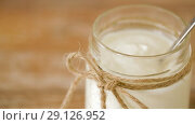 Купить «close up of yogurt or sour cream in glass jar», видеоролик № 29126952, снято 21 августа 2018 г. (c) Syda Productions / Фотобанк Лори