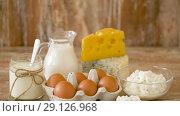 Купить «chicken eggs, milk, sour cream and cottage cheese», видеоролик № 29126968, снято 21 августа 2018 г. (c) Syda Productions / Фотобанк Лори