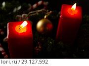 Купить «Christmas red square candles», фото № 29127592, снято 19 сентября 2018 г. (c) Wavebreak Media / Фотобанк Лори