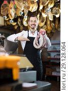 Купить «Seller weighing sausage», фото № 29128064, снято 2 января 2017 г. (c) Яков Филимонов / Фотобанк Лори