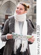 Купить «girl in historical city in scarf holding map», фото № 29128220, снято 11 ноября 2017 г. (c) Яков Филимонов / Фотобанк Лори