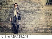 Купить «teenager girl in hood near wall», фото № 29128248, снято 11 ноября 2017 г. (c) Яков Филимонов / Фотобанк Лори